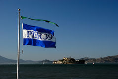 Pier 39 flag and alcatraz Stock Photos