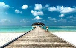 Pier aan een Strand Cabana Stock Afbeelding