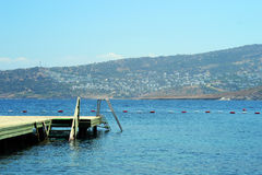 Pier in Aegean Sea. At sunny day Royalty Free Stock Photo