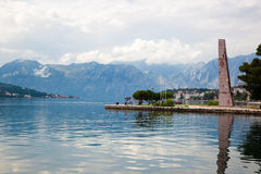 Pier against backdrop of mountain scenery Stock Photos