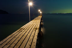 Pier Against Dark Sea Foto de archivo libre de regalías