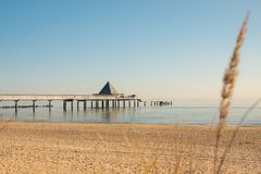 pier of Ahlbeck in the early morning in sunshine stock photography