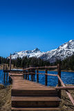 Pier on Alpine lake in Engadin - 2 Stock Image