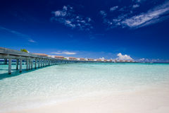 Pier with aqua villas on the horizon Royalty Free Stock Photography