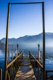 Pier auf dem Lugano See Stockfotos