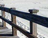 Pier auf dem Sand Stockfotos