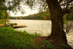 Pier on autumn lake. This is tranquil scene stock photos