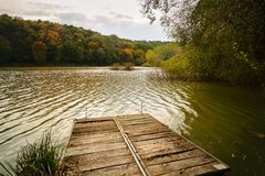 Pier on autumn lake. This is tranquil scene royalty free stock photos