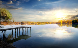Pier on autumn river Stock Image