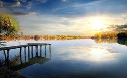 Pier on autumn river Stock Image