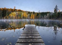 Pier. Autumn at a small lake with a pier Royalty Free Stock Images