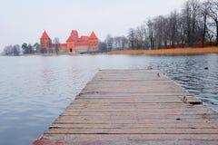 Pier in the background of Trakai Castle Stock Photo