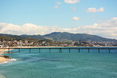 Pier on Badalona beach in Barcelona. Coast of the Mediterranean Sea Stock Photography