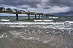 Pier at the Baltic sea. Pier in Boltenhagen (Germany) on a windy evening Royalty Free Stock Image