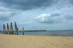 Pier by the Baltic Sea. Cloudy sky above a pier by the Baltic Sea in Gdynia Orłowo Royalty Free Stock Photography