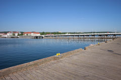 Pier At Baltic Sea In Sopot. Wooden pier in town of Sopot in Poland, Baltic Sea bay, popular tourist vacation destination Stock Photos