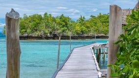 Pier of Bamboo Huts, Kordiris Homestay, Palmtree in Front, Gam Island, West Papuan, Raja Ampat, Indonesia. Pier of Bamboo Huts, Kordiris Homestay, Palmtree in Stock Image