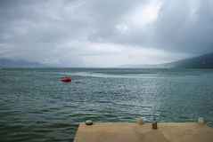 Pier. In the Bay of Kotor - cloudy summer day Royalty Free Stock Photography