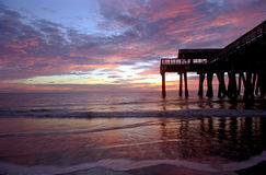 Pier at the Beach. Sunrise with pier at Tybee Island, Georgia Stock Photography