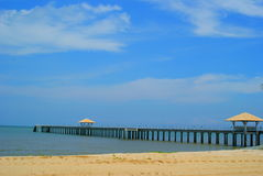 Pier on beach Royalty Free Stock Photo