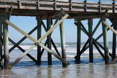 Pier on beach Royalty Free Stock Photos