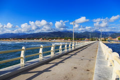Pier, beach and Apuane mountains in Forte dei Marmi Versilia Tus Royalty Free Stock Images