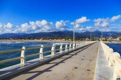 Pier, beach and Apuane mountains in Forte dei Marmi Versilia Tus Royalty Free Stock Images