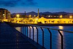 Pier at beach of Badalona  in evening Stock Photo