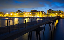 Pier at beach of Badalona  in evening Stock Images
