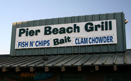 Pier Beach Grill. At this snack shack at the pier, you can get fish, chowder and bait royalty free stock photos