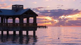 Pier at the beach in Key West. Pier at the beach on sunrise in Key West, Florida USA. Raw video source stock video footage