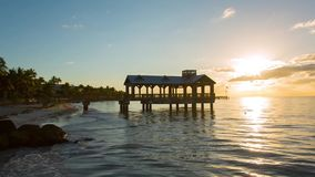 Pier at the beach in Key West. Pier at the beach on sunrise in Key West, Florida USA. Raw video source stock footage