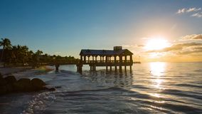 Pier at the beach in Key West timelapse. Pier at the beach on sunrise in Key West, Florida USA. Timelapse stock footage