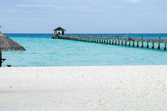 Pier on the beach, Maldives. The Maldives in October, indian ocean, Ari Atoll Royalty Free Stock Photography