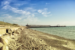 Pier beach and ocean. Early morning on the island. Martha's Vineyard. US East Coast Stock Photography