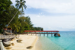 Pier on the beach at Pulau Perhentian, Malaysia. Relax on a deserted beach in an island of Tropical paradise. Pier on the beach at Pulau Perhentian, Malaysia Stock Image