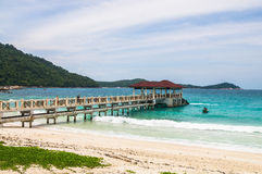 Pier on the beach at Pulau Perhentian, Malaysia. Relax on a deserted beach in an island of Tropical paradise. Pier on the beach at Pulau Perhentian, Malaysia Royalty Free Stock Photography