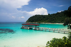 Pier on the beach at Pulau Perhentian, Malaysia. Relax on a deserted beach in an island of Tropical paradise. White sand Turtle beach with pier at Pulau Royalty Free Stock Images