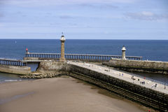 The pier and beach Whitby North Yorkshire England. Whitby is a historic town in North Yorkshire on the north-east coast of England. Nowadays it is a fishing port Royalty Free Stock Photos
