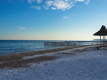 Pier on the beach. In the winter snow Stock Images