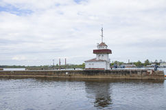 Pier with the beacon Kronstadt Russia. Pier with the beacon in Kronstadt Russia Royalty Free Stock Images