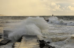 Pier and beacon under storm Stock Image