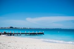 Pier in beautiful beach with turquoise water in Grace Bay, Provi. Denciales, Turks and Caicos Stock Image