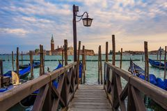 Pier and beautiful evening view on Island of Saint Giorgio Maggi Royalty Free Stock Photography