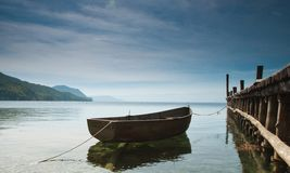 The Pier. The beauty of the lake and the boat caught up in the dock Stock Images