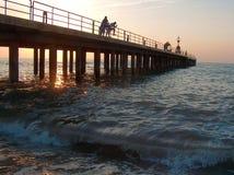 Pier bei Sonnenuntergang Stockbild