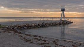 Pier at Bellevue beach. The pier at Bellevue beach during a summer sunrise Stock Images