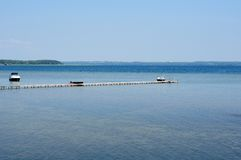 Pier on the big lake under the blue sky Royalty Free Stock Images