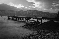 Pier. A black and white rendition of a long exposure and a pier Royalty Free Stock Photo