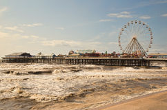 The pier at Blackpool with large ferris wheel and waves. Stock Photos